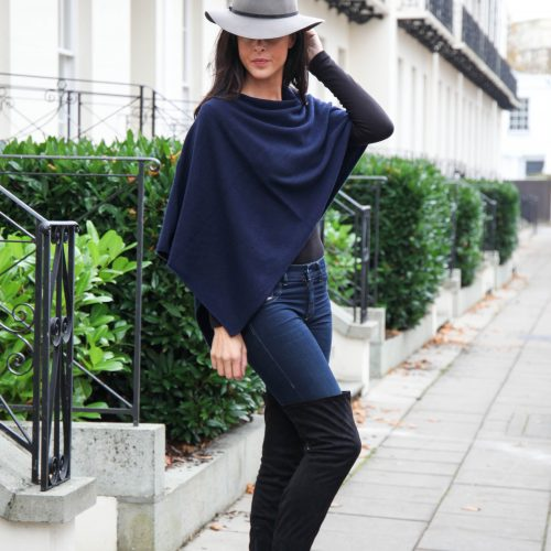 A lady wearing an Anise Cashmere Navy Short Wrap