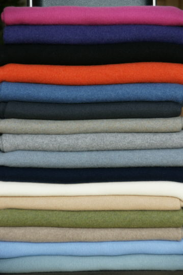 A pile of all our Classic Cashmere Wraps